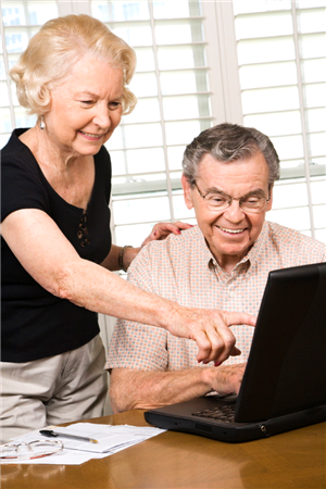 Older Couple At Computer Image